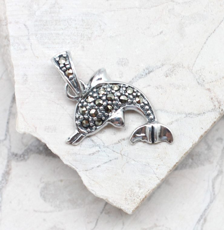 A photo of the The Dancing Dolphin Pendant product