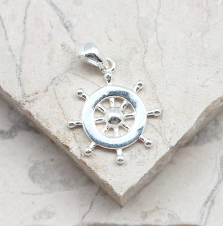 A photo of the The Ship Wheel Pendant product