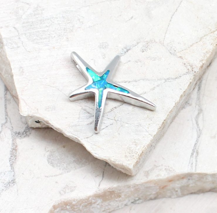 A photo of the The Opal Starfish Pendant product