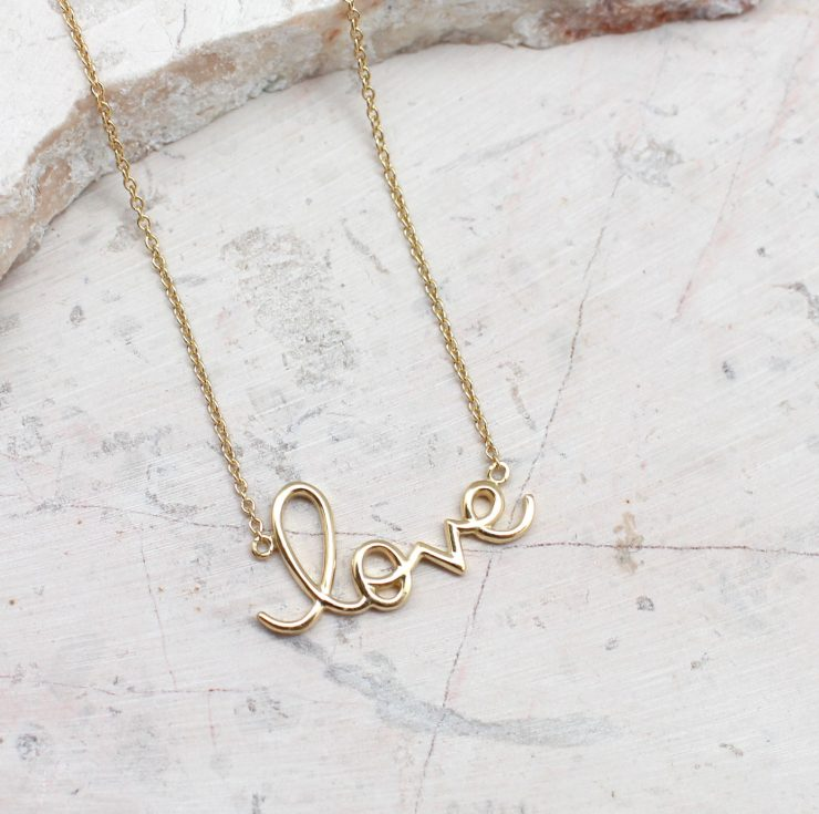 A photo of the Golden Love Necklace product