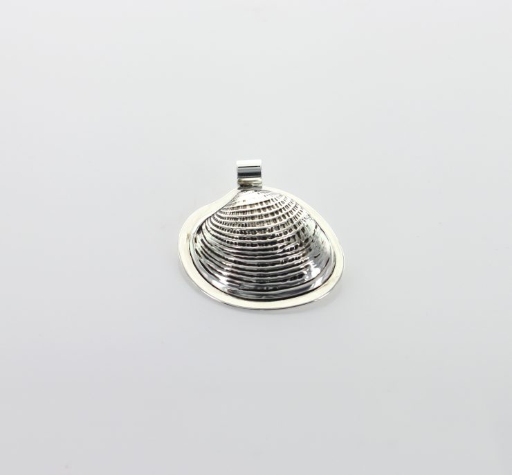 A photo of the Scallop Shell Pendant  product