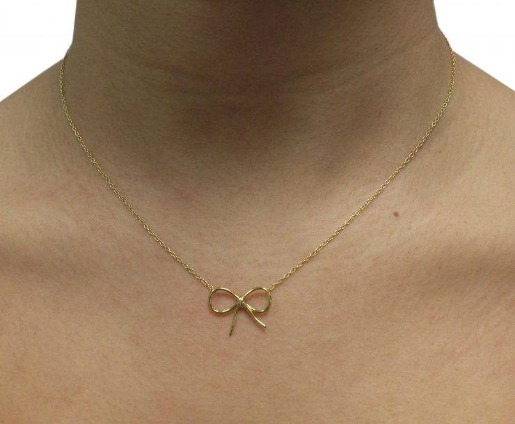 A photo of the Speared Triangle Necklace product