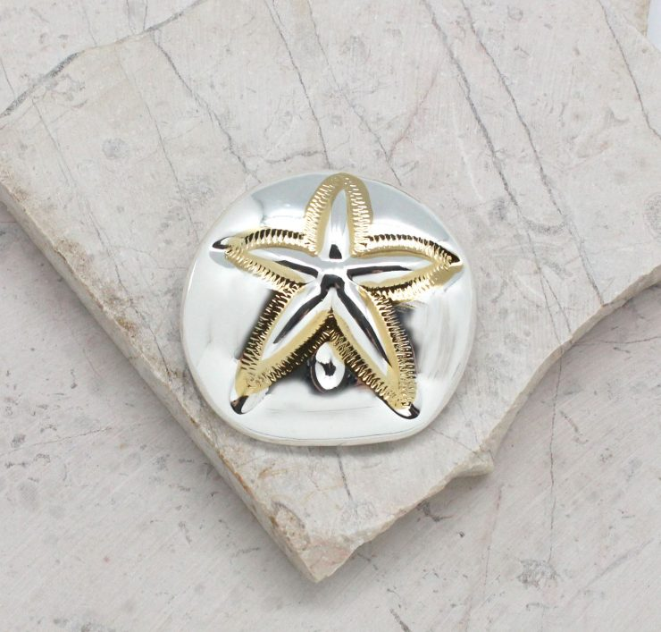 A photo of the Sea Biscuit In The Sun Pendant product