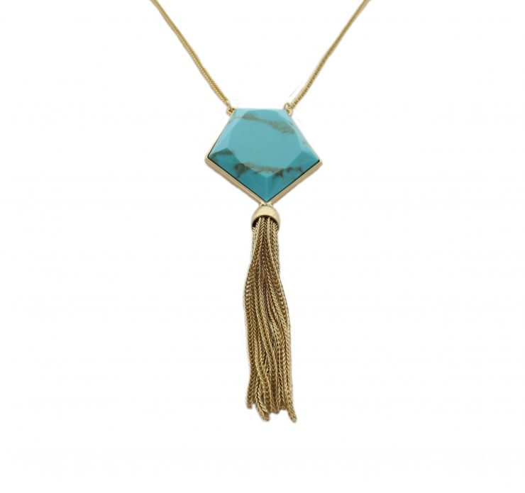 A photo of the Long Turquoise Tassel Necklace product