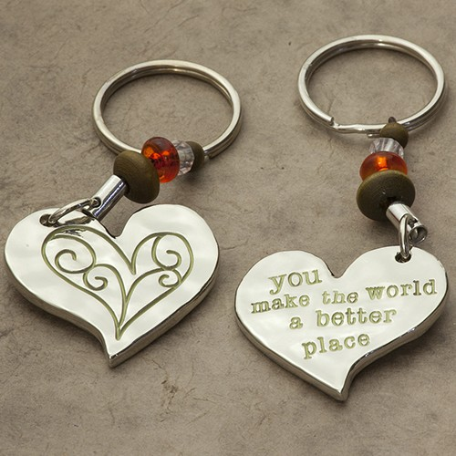 """A photo of the """"You Make The World"""" Keychain product"""