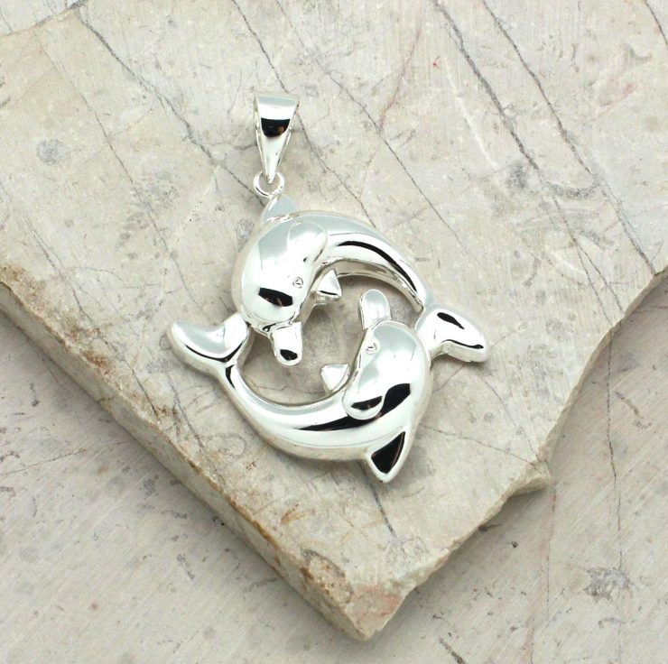 A photo of the Friendly Dolphins Pendant product