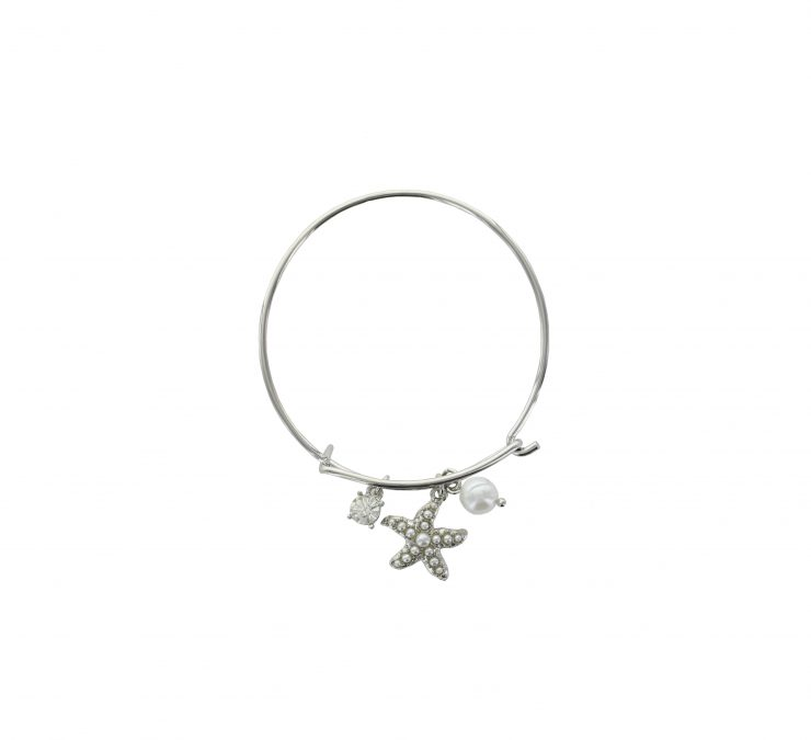 A photo of the Starfish Pearl Bangle product