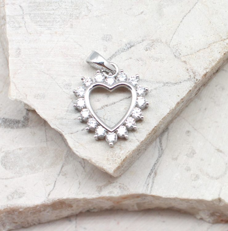 A photo of the The Giving Hearts Pendant product