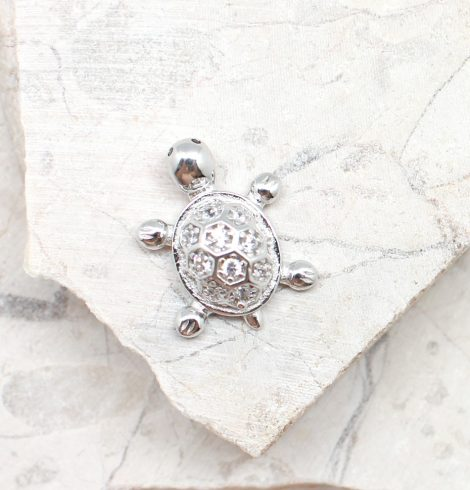 A photo of the The Tiny Turtle Pendant product
