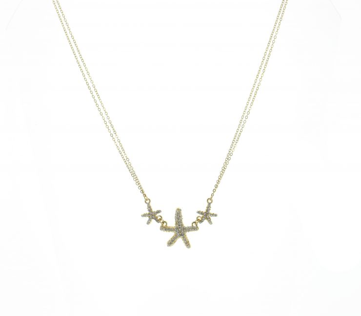 A photo of the Starfish Trio Necklace product