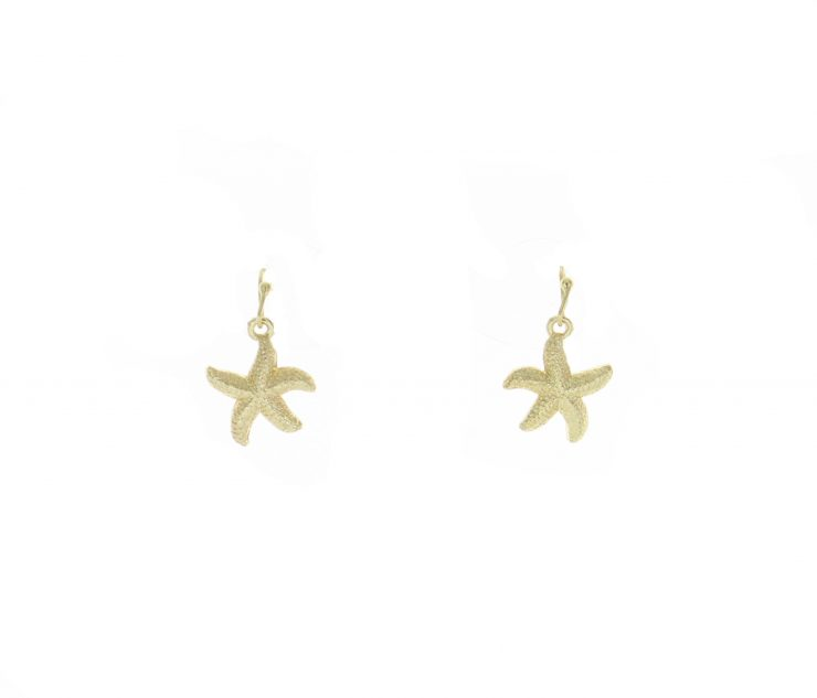 A photo of the Gold Starfish and Pearls Necklace product