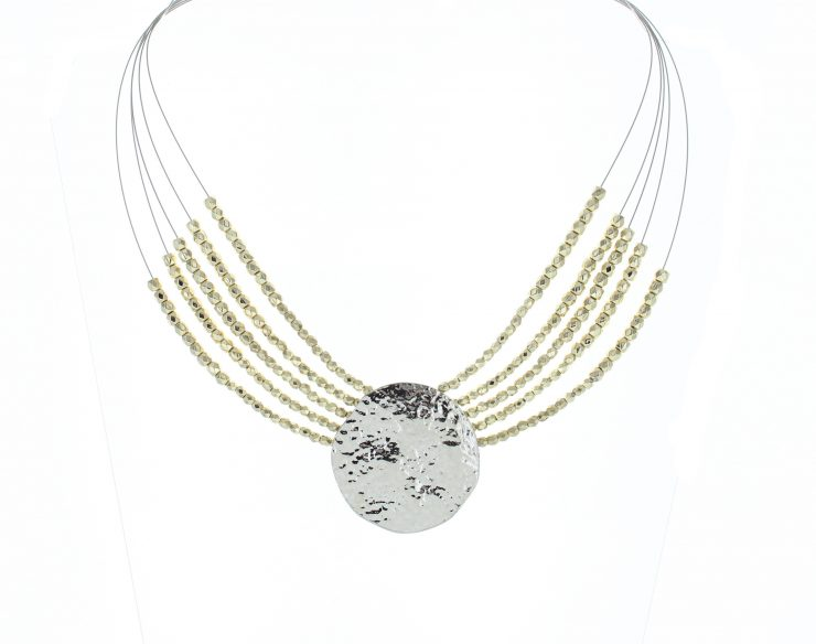 A photo of the Two Tone Wire Coin Necklace product