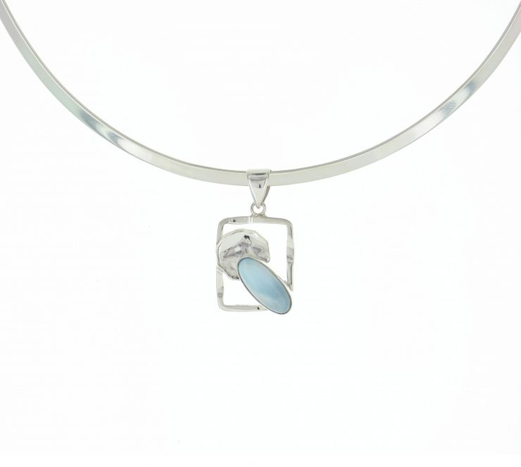 A photo of the Small Square Frame Larimar Pendant product