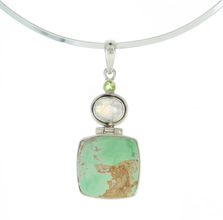 A photo of the Moon Stone and Green Turquoise Pendant product