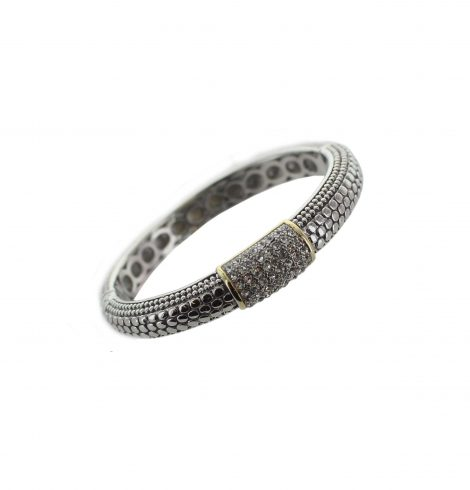 A photo of the Metal Dots Bangle product