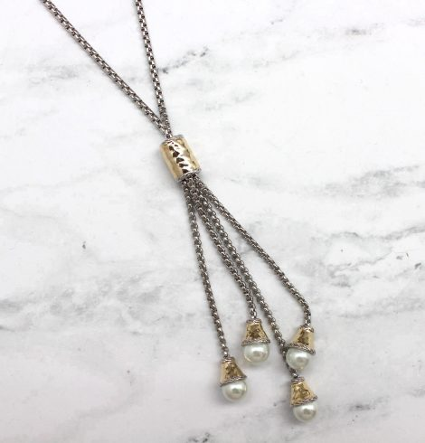 A photo of the Pearl Drops Necklace product