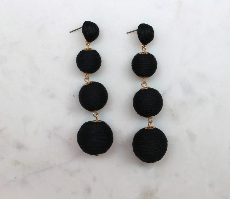 A photo of the Post Silk Ball Earrings product