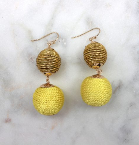 A photo of the Two Tone Thread Ball Earrings product
