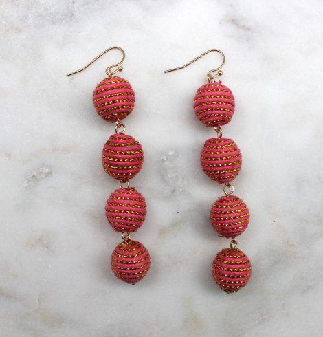 A photo of the Shimmer Thread Wrap Ball Earrings product