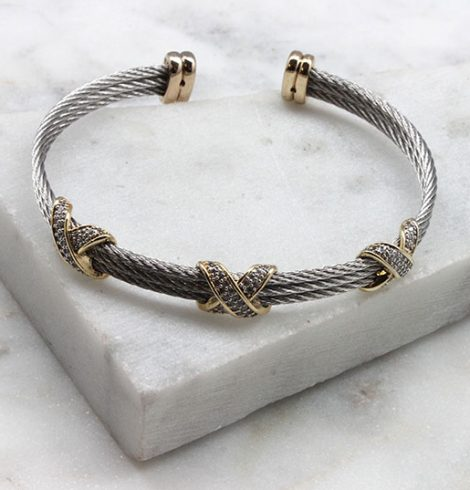 A photo of the X's Cuff Bracelet product