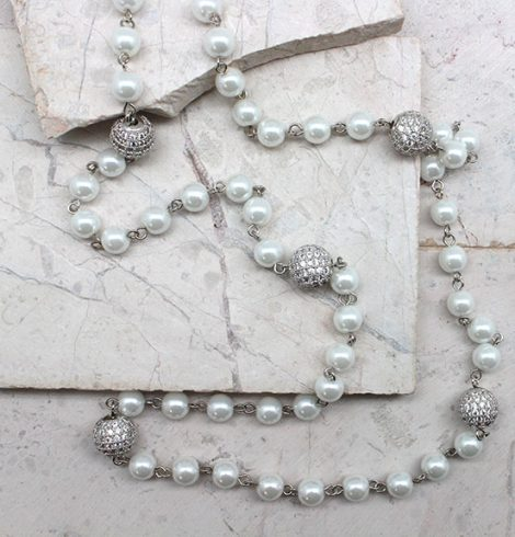 A photo of the Pearls & Fireballs Necklace product