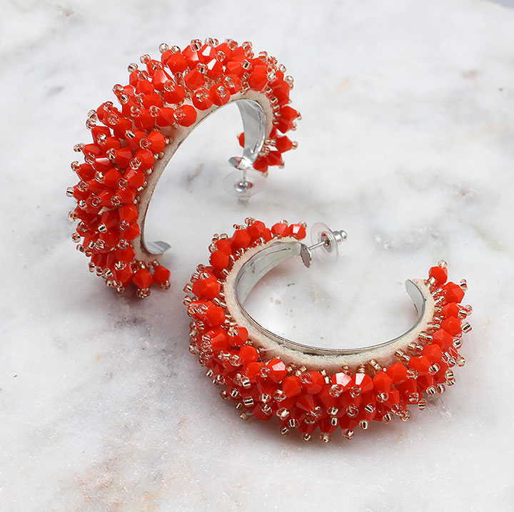 A photo of the Beaded Moon Earrings product