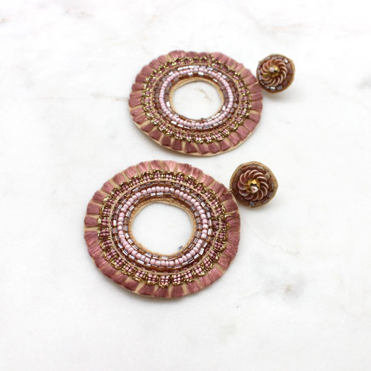 A photo of the Rose Realness Earrings product