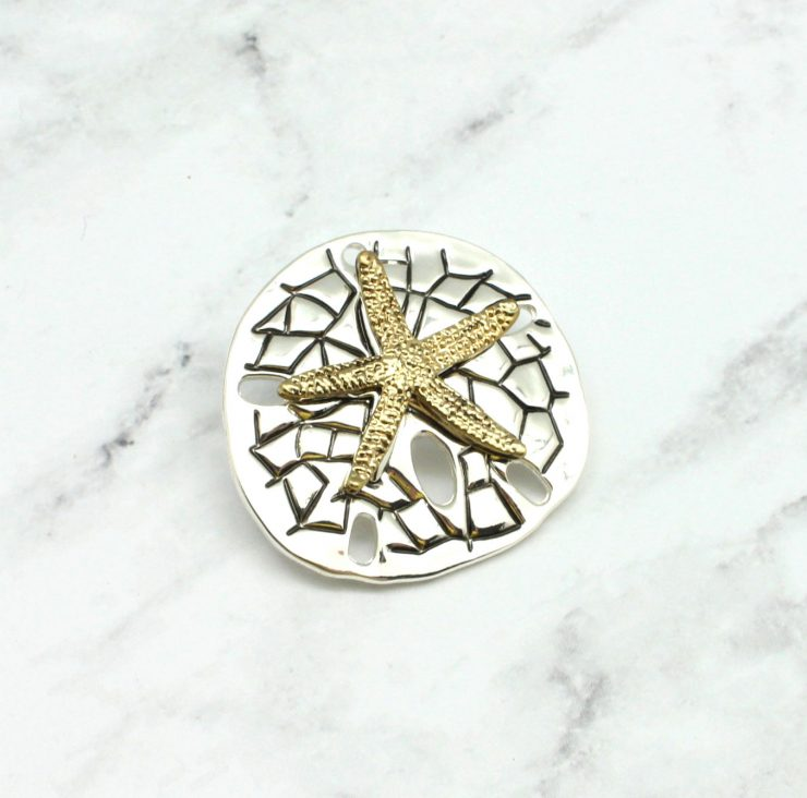A photo of the Starfish On The Bay Pendant product