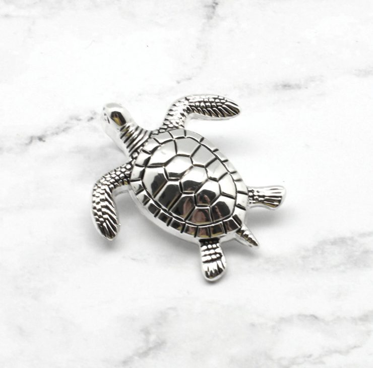 A photo of the Terrific Turtle Pendant product