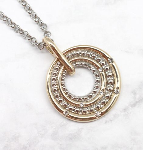A photo of the Circling Into The Target Necklace product
