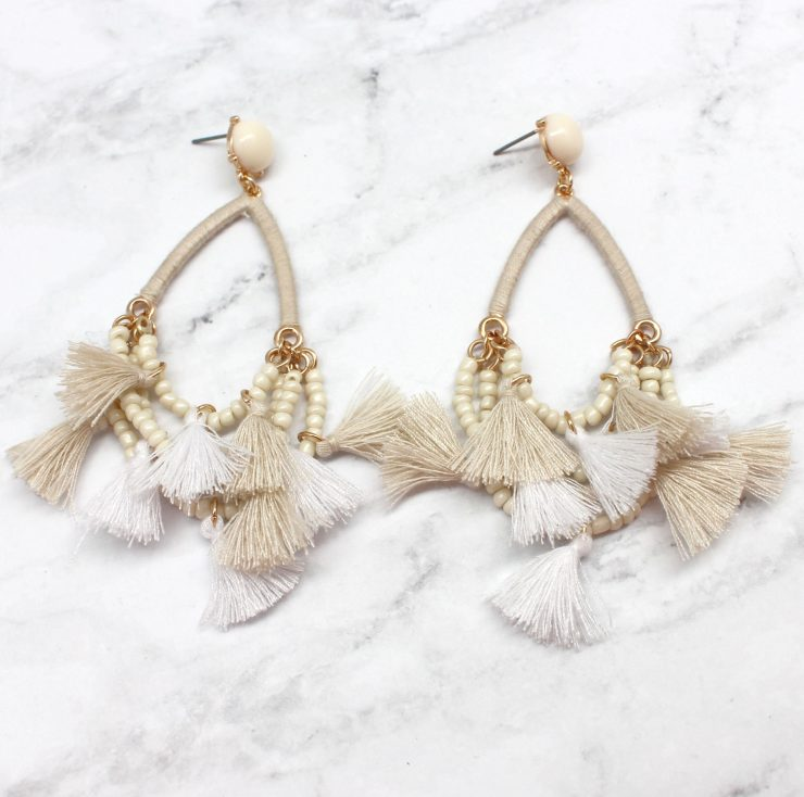 A photo of the Delicate Duster Earrings product