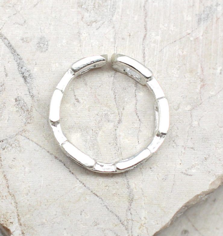 A photo of the The Link Toe Ring product