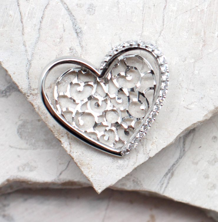 A photo of the The Cut Out Heart Pendant product