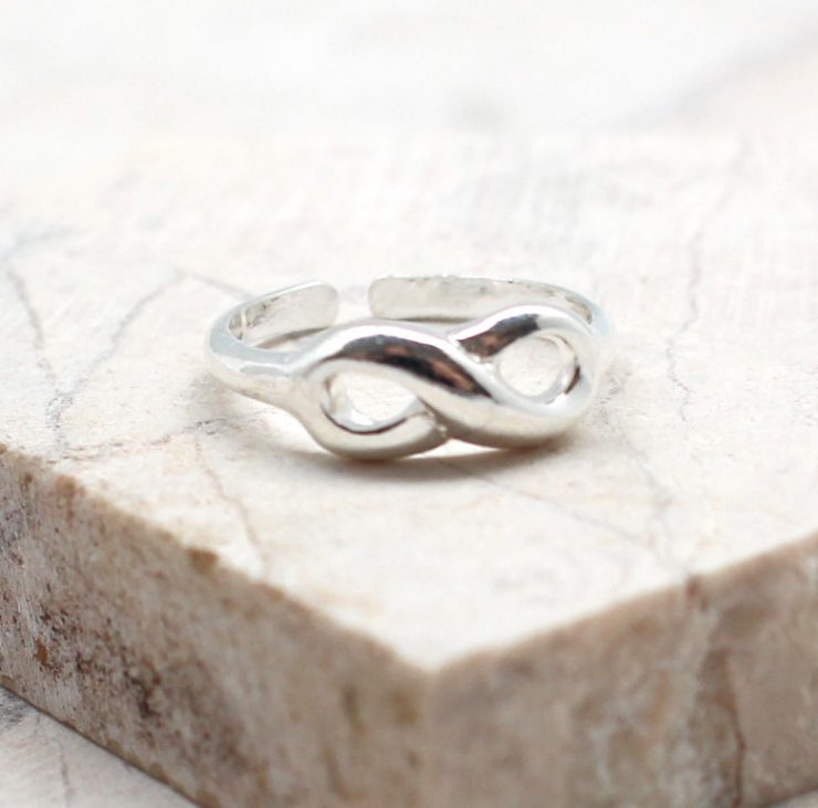 A photo of the The Infinity Toe Ring product