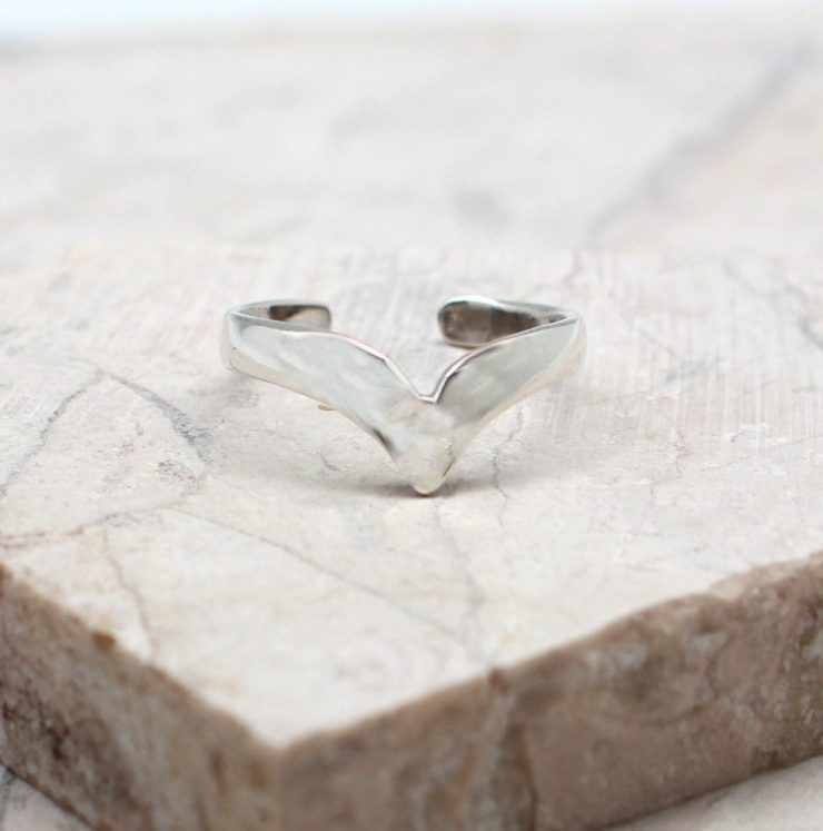 A photo of the The V Toe Ring product