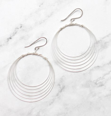 A photo of the The Carnation Earrings product