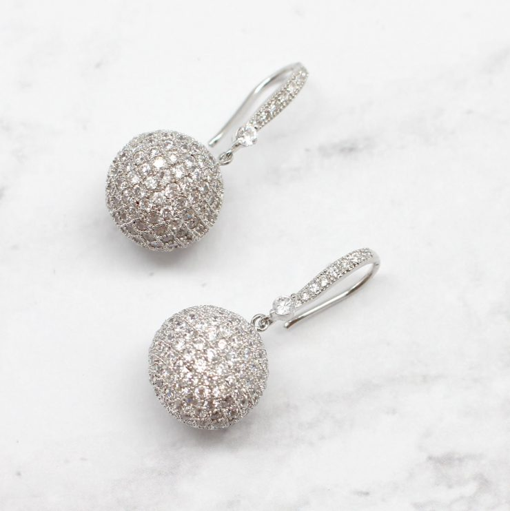 A photo of the Like A Disco Ball Earrings product