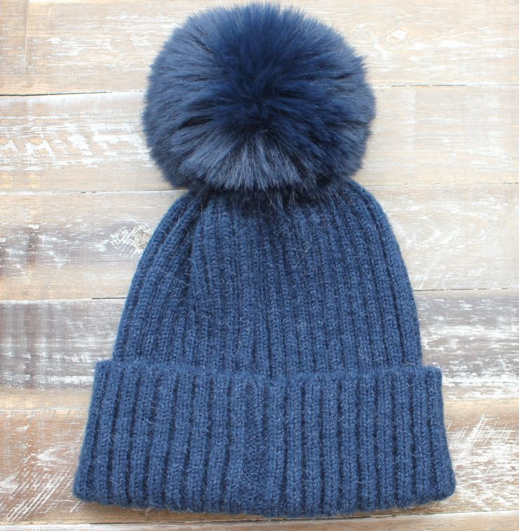 A photo of the The Regina Pom Pom Hat product
