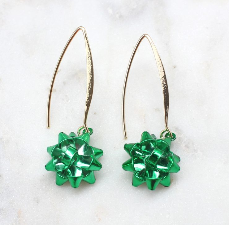 A photo of the Christmas Bow Dangle Earrings product