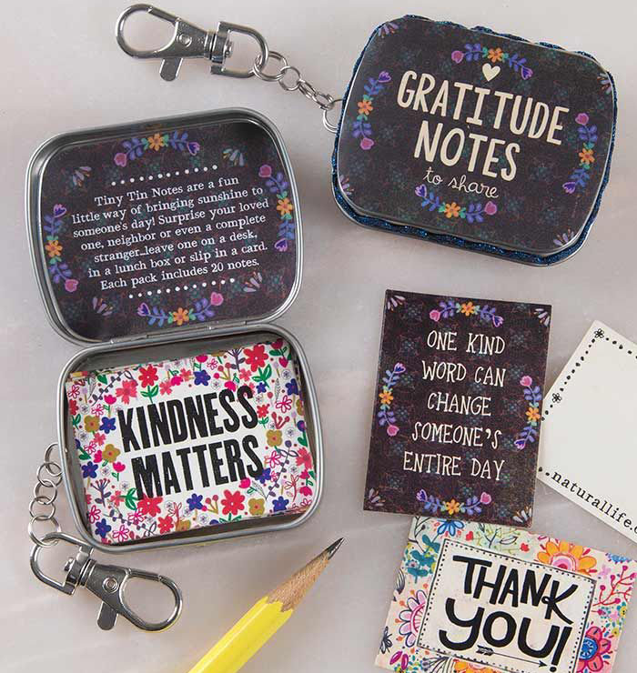 A photo of the Key Chain Tiny Tin Notes product