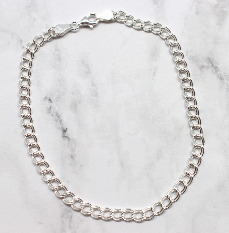 A photo of the Lovely Link Anklet product