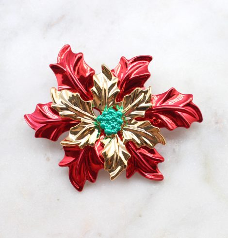 A photo of the Poinsettia Pin and Pendant product