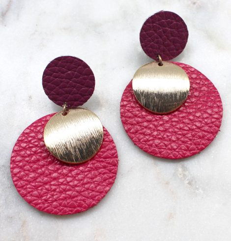 A photo of the Right On The Button Earrings product