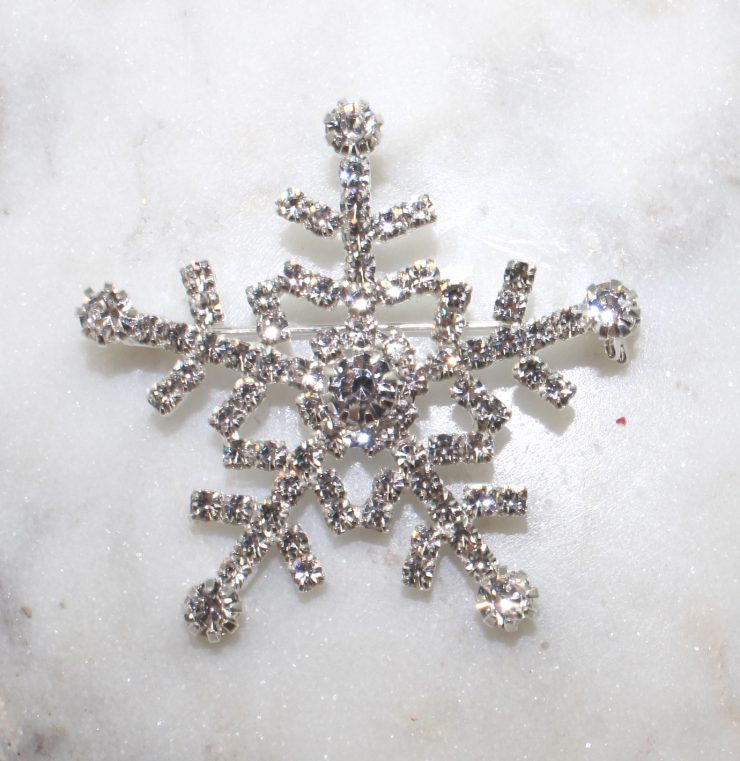 A photo of the Snowflakes Falling Pin product