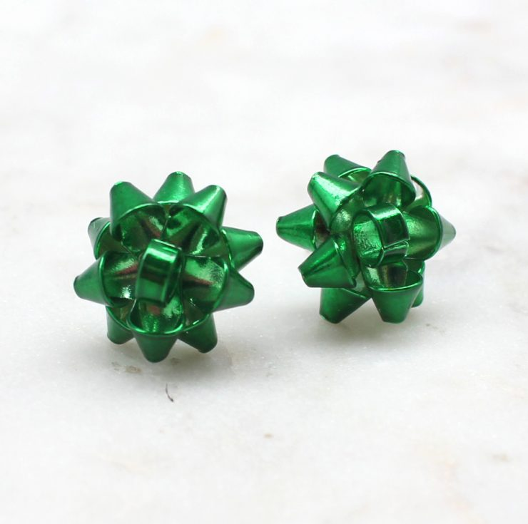 A photo of the Christmas Bow Stud Earrings product