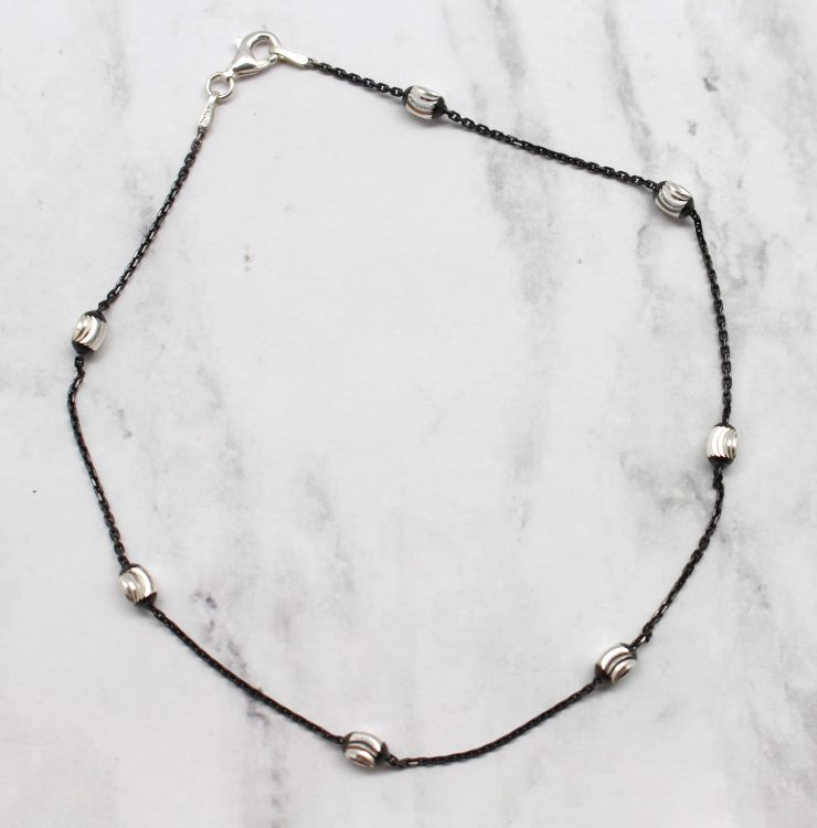 A photo of the Black Wave Runner Anklet product