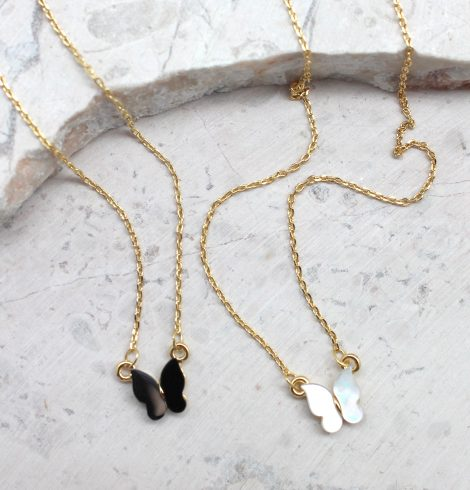 A photo of the Fly With Me Necklace product