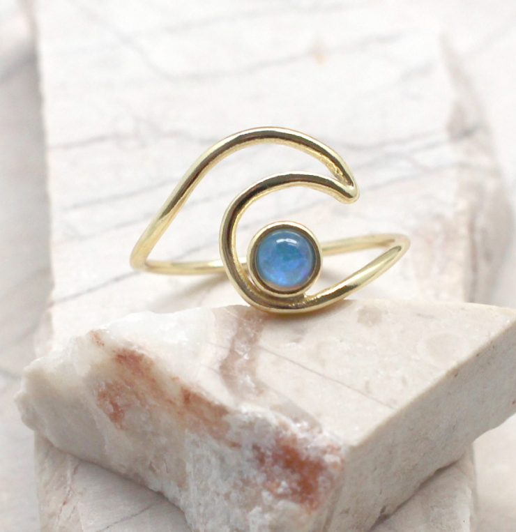 A photo of the Wave Ring With Opal Stone product
