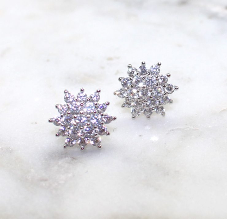 A photo of the Sunburst Earrings product