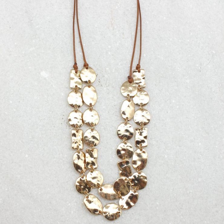 A photo of the Gold Pieces Necklace product